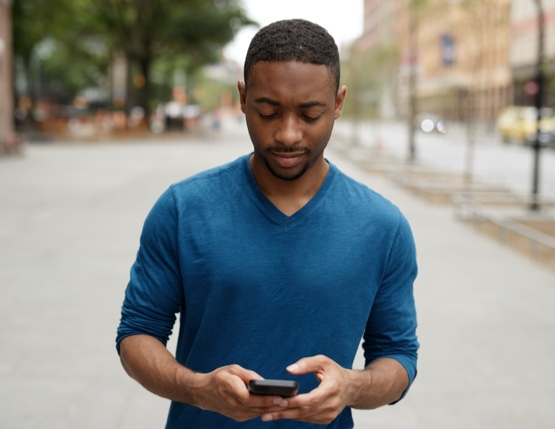 man looking at a mobile device